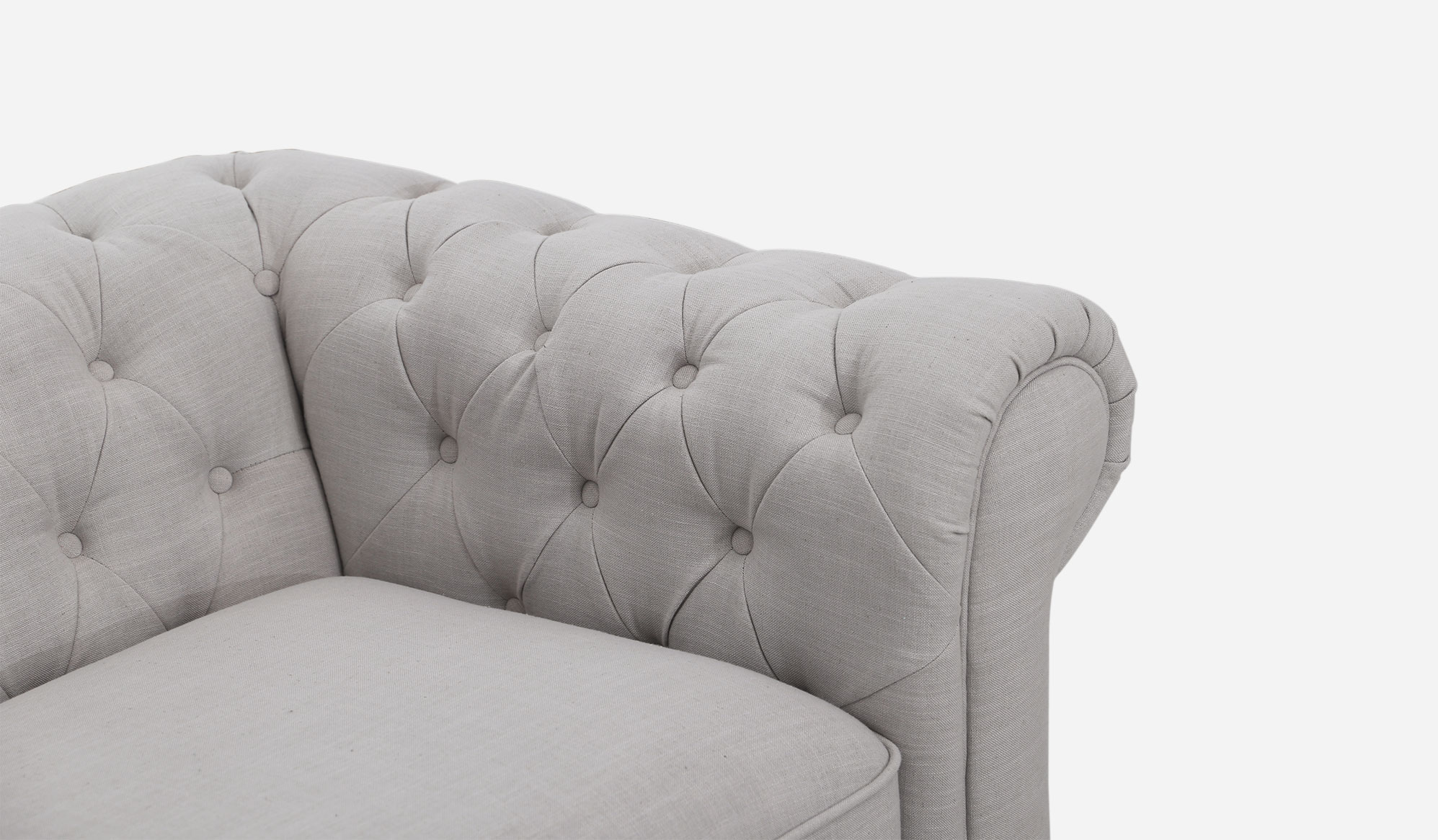 White Chesterfield Chair - A classically elegant sofa the buttoning adds texture shape and volume to the piece while the scrolled arms bring just the right amount of gentlemanly